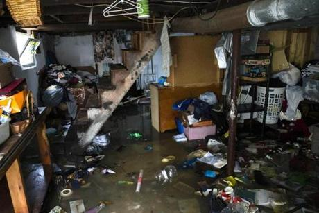 A shot from March 5 shows the kind of damage flooding from a big storm can do. This is the basement of a home in Quincy.